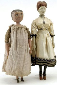 """Early 19th century English bedpost doll with blue glass eyes, painted hair, wooden arms and legs. Also an early 20th century carved folk art woman, fully jointed wood body, painted features, wearing vintage silk dress with jewelry Size: dolls 14.5"""" t."""