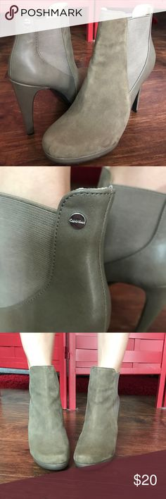 Calvin Klein high heel booties Calvin Klein high heel booties. Griege color. Little damage on heel (see last picture). Suede & leather Calvin Klein Shoes Ankle Boots & Booties