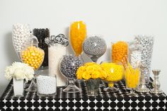 Silver, Yellow, Black, and White Candy Buffet. I think a whit lace or a burlap trimmed in lace table cloth would be be beautiful with this!