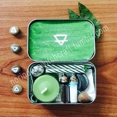 """norindoeswitchcraft: """"Tiny earth witch travel altar with • Element Symbol Runes • Dry Mint Leaves • Green Tea Candle • Matches • 2 White Birthday Candles • 2 Green and White Striped Birthday Candles •..."""