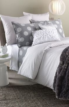 Absolutely loving this grey palette and those adorable polka dotted pillows!