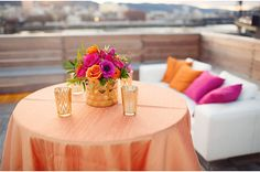 Bridal Bliss: Crisp white sofa with vibrant accents in oranges and pinks.