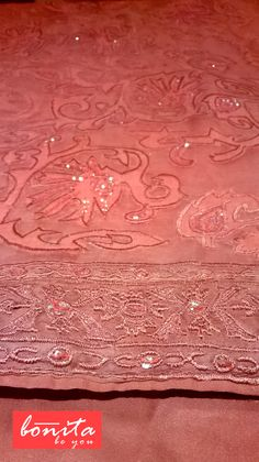 all over applique on peach muslin, to know the detail, contact https://www.facebook.com/BONiTAdesignerstudio