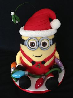 Christmas Minion.  Our new Santa Minion from Looby Loo Cake Company.  He will soon be on display in a Christmas window.