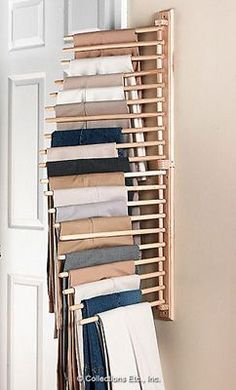 Wall Mount Trouser Pant Closet Organization Rack. I found this at a second hand store and it was stolen when my son left it on the back of my car. So I looked for and found it online and ordered two. I can't wait to use it for my closet but I also thought it would work to hang kitchen utensils using S hooks as well. We shall see.