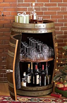 wine barrel bar ~ We picked up a barrel at an antique shop, hoping we can do something like this.  Derek would love this !! Lol