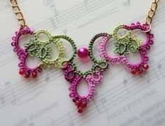 Pink Crochet Necklace Laying on Music Book