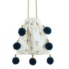 LALA // GAIA pom pom bags are made from vintage + repurposed fabric by resettled refugee women living in Dallas // www.gaiaforwomen.com