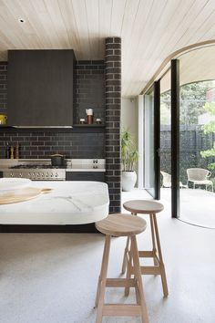 Black Brick House Give a Different Look to Your House Black Brick House. What do you think of the black brick house? In another hand, the black brick … Kitchen Marble, House Design, Brick Kitchen, Brick Interior Wall, Brick Wall Kitchen, Terrazzo Flooring, Australian Homes, Flooring Trends, Brick House