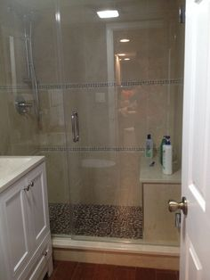 Added a frameless shower with vanity & toilet.
