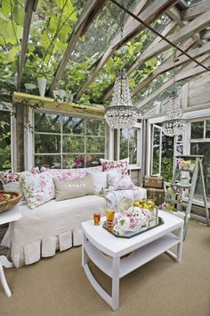 This newly fashioned getaway is furnished with vintage-floral pillows, white-painted furniture, and collections of mint green jadeite and milk glass vases.
