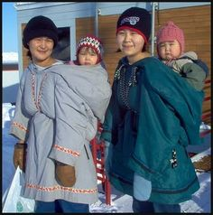 Amauti Babywearing. *The amauti is the parka worn by Inuit women of the eastern Canadian arctic. Up until about 2 years of age, the child nestles against the mother's back in the amaut, the built-in baby pouch just below the hood. The pouch is large and comfortable for the baby.