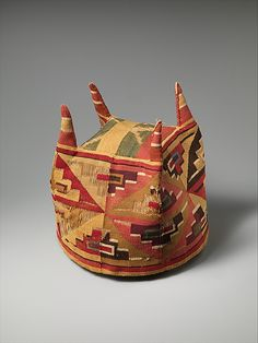 Four-Cornered Hat Date: 7th–9th century Geography: Peru Culture: Wari Medium: Camelid hair, cotton Dimensions: Overall: 22 1/2 x 7 in. (57.15 x 17.78 cm) Other: 22 1/2 in. (57.15 cm)