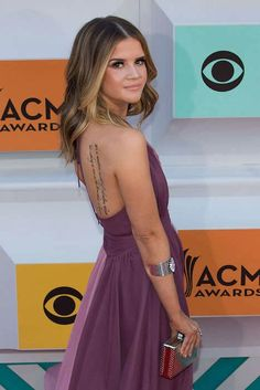 Maren Morris shows off her tattoo at the 51st Academy of Country Music Awards in Las Vegas on April 3, 2016...