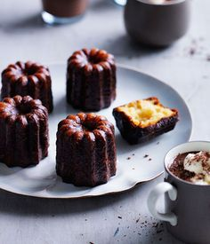 Australian Gourmet Traveller recipe for canelés with spiced hot chocolate.