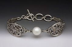 Vintage style spoon handle bracelet with Swarovski pearl.