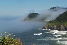 The #HecetaHeadLight in #Oregon, covered in #fog on a #sunny day.