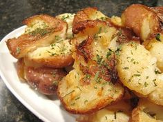 cracked potatoes - great way to make red potatoes! Why didn't I think of this? After boiling to tender, draining, and tossing with butter and seasoning, place on baking sheet and smash gently with fork. Then crisp in oven!
