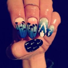 If you're deep into fashionable nail art then you should try out this amazing looking summer sunset nail ensemble. Looking great in midnight blue hues and sunset background, silhouettes are painted over the gradient background to emphasize the end of a fun summer day. Aside from the silhouette coconut trees, bold shapes and white crosses are also painted to add more depth into the design.