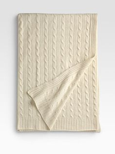 This cream colored cashmere blanket has made homes of hotel rooms and eased many nights racked with insomnia