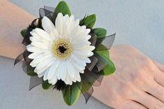 White gerbera daisy, add rhinestone to center, red ribbon