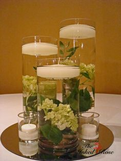like the idea of flower/plants in the water under candles but would change it up