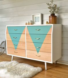 Original 60s chest of drawers. Painted in gloss white, with raw timber drawers and teal geometric feature. http://www.rawrevivals.com.au