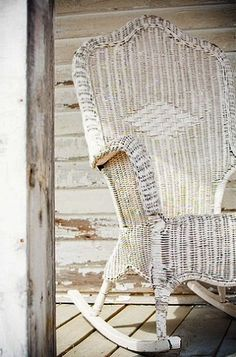 .memories in Petoskey of the wicker rocker on the porch.