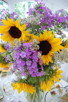 Sunflowers!  Don't know what the tiny white flowers are but they are perfect in this arrangement.  Just love it.  !