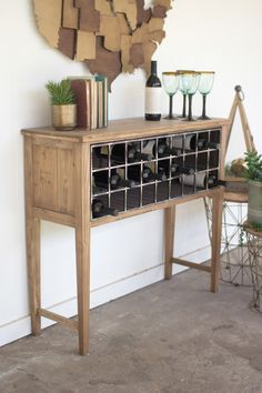 """With a classic appeal, this wooden console features a metal grid storage rack which is perfect for storing and displaying your bottles of wine. 40"""" x 14"""" x 35""""t"""