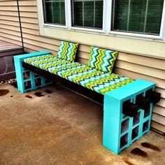 garden furntiure ideas DIY cinder block bench blue paint colorful decorative pillows and pad