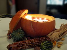 like this idea. Floating candles in a pumpkin.