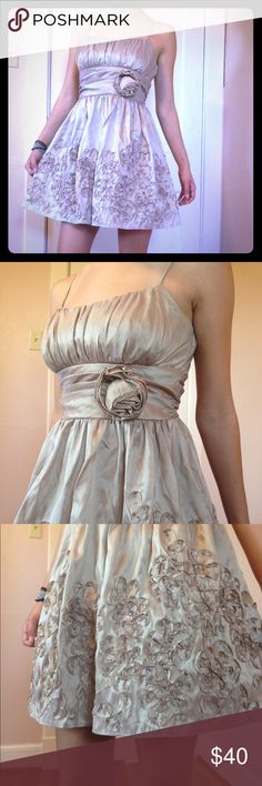 GORGEOUS B. Darlin dress!! Never worn except to try on! This dress is super cute! It's tan color, mixed with the shine gives it a classy gold look! It has beautiful patterns alone with an elegant rose on the waist! 💖 B. Darlin Dresses Prom
