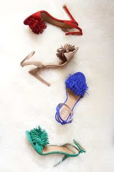 Our new Honey Fringe Sandals will go with just about everything this Spring season. Dress up your street style with these fringe heels in soft blue, red, green, tan and black suede | Banana Republic