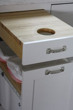 Cutting board drawer over garbage... now THAT is mindblowingly logical.
