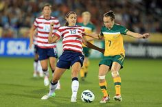 Alex Morgan and Caitlin Foord battle for control of the ball during yesterday's match between the U.S. and Australia. Morgan had two goals and two assists in a 6-2 U.S. victory. (Doug Pensinger/Getty Images)