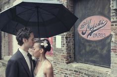 Simple black umbrella can look great in wedding photos if it's raining...