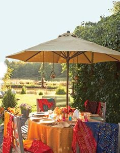 A giant umbrella shields party guests from the blazing afternoon sun, and hanging lanterns will illuminate the table come nightfall.