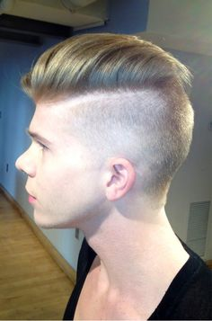 By Kelly Morezak. His haircut fades front to back, as opposed to up and down... #1 in front - #4 in back, also I etched out his part w a straight-blade so it looks more defined...haircut is symmetrical on top..