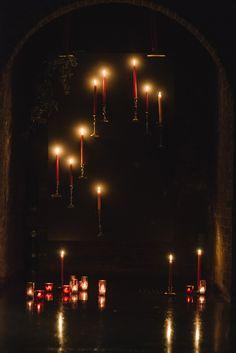 DIY floating candlestick backdrop - photo by Divine Light Photography http://ruffledblog.com/diy-floating-candlestick-backdrop