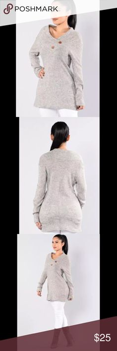 Fashion Nova Rain on Roof Gray Tunic Sweater Features an over-sized V collar, two brown button detail, and long sleeves.  Style: Rain on the Roof  Color: Heather Gray  Size: Small  Material: 68% Angora, 17% Nylon, 15% Polyester  Retail Price: $27.99  Condition: New with tag Fashion Nova Sweaters