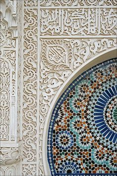 Alhambra - Granada, Spain (the top horizontal segment seems to have Arabic script (stylized) layered over a geometric design underneath. By stylizing the letters, they can both hide in the decoration and be separated for reading!