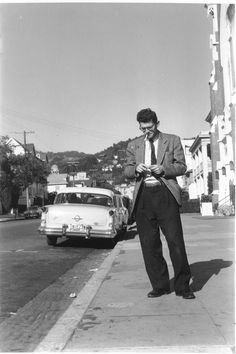 Allen Ginsberg in Berkeley [on Durant Avenue, rw] probably late 1954, dressed up for working at his Market Research job. (c) Allen Ginsberg Estate.
