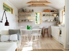 Cottage: Pale floors, green accents, windows, reading light, brightness, simplicity, function