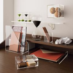 """format storage shelf in storage   CB2  $24.95   wall mounted acrylic display cube, comes in various sizes/shapes    SKU: 348697  dimensions: 6""""sq.x6""""Hdetails:Clear"""