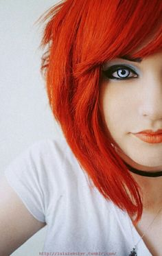 Cool effect with bright red hair, red lipstick and cool special effects contacts