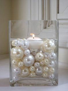Pearls floating water in square votive 1920s Art Deco Great Gatsby Party weddings centerpieces table settings linens roaring 20s vintage off white candle fire light decor decoration