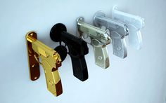 If It's Hip, It's Here: Gun-Shaped Doorknobs Function Like A Real Pistol: Pulling The Trigger Unlocks The Door.