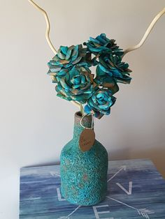 "Nothing says ""Relax!"" like these five roses made from gold and aqua Thai Marbled Momi (artisanal paper) chilling in a beautiful beach-vibe vase. Available with either dark or light branches. Lighted Branches, Beautiful Beaches, Paper Flowers, Chill, Aqua, Artisan, Relax, Roses, Dreams"
