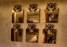 """Wall Mirrors:   Hand forged steel and a crystal floral ornamentation at top make these mirrors unique as well as classy. On a powder room wall, bedroom, or just about anywhere in your home. Available as a group or single.    12"""" x 12""""mirror. Overall height 16""""  www.brumbaughs.com"""